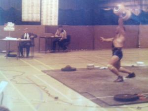 Ernie with a 75kg dumbbell swing at 75kg bodyweight, 1977